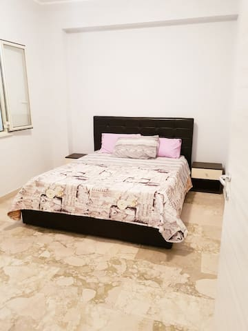 The bedroom sleeps two guests comfortably with ample storage and space for guests' luggage