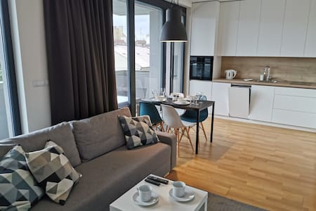 Cozy apartment with private parking