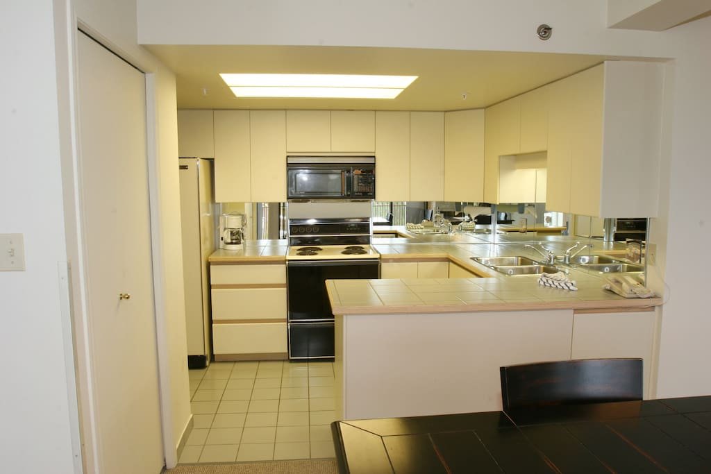 The fully-equipped kitchen features modern appliances.