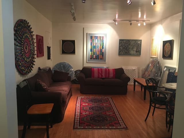 Shared living room with comfortable couches for downtime. This area also serves as an art gallery and the walls are adorned with all original artwork. (All artwork is for sale)