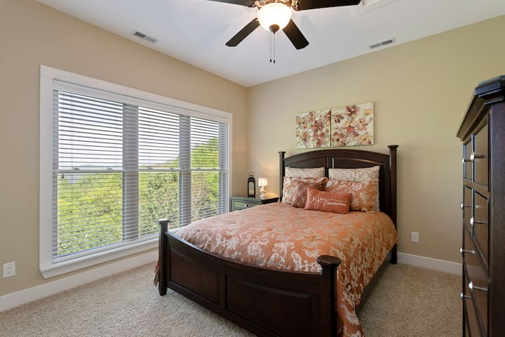 Lower level Queen bed with a lake view
