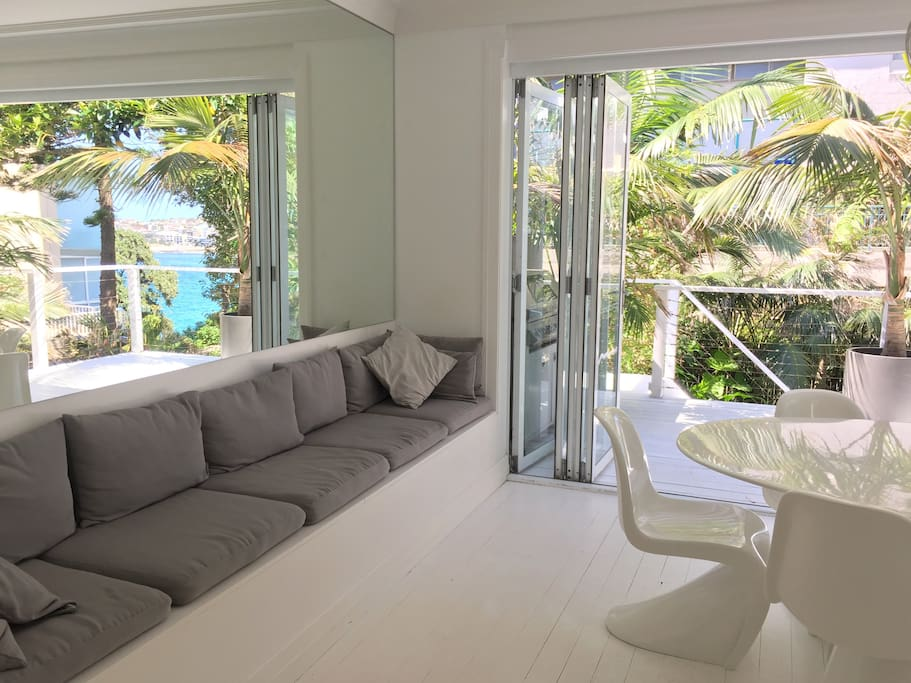 Beach seat near balcony and dining area with supersized mirror to maximise the view and add a lot of space and light. Favorite place to sit and relax or entertain.
