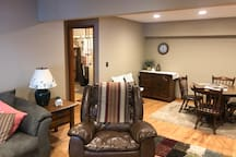 A view of the sitting area and the utility room with washer and dryer off the lower living room