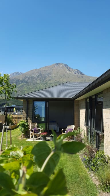 From garden looking onto bedroom, with The Remarkables mountain range in background