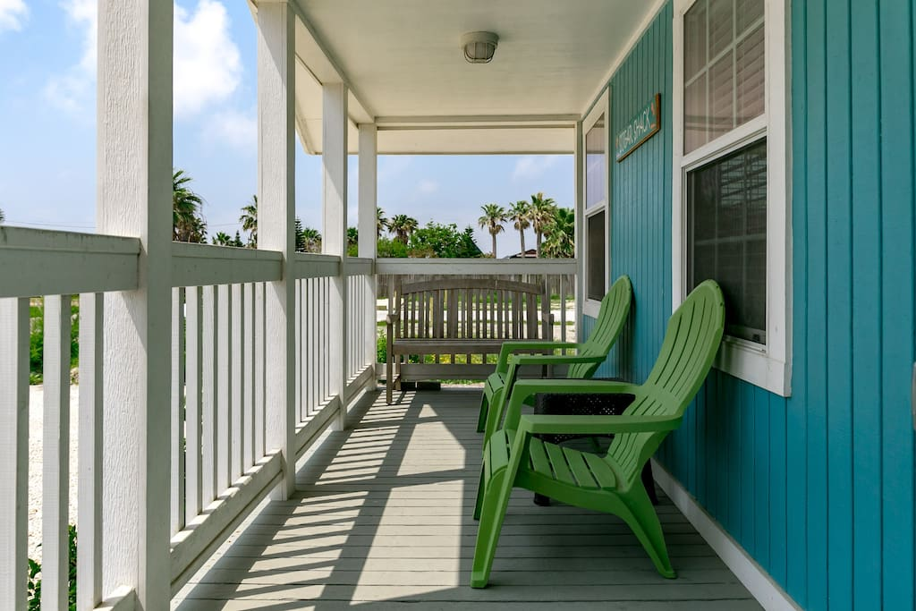 A pair of Adirondack chairs on the porch.