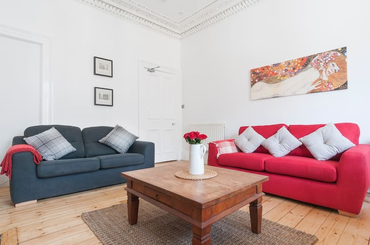 Relax after a long day sightseeing or shopping. The red sofa turns in to comfy bed!