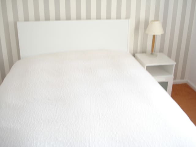 Warm, clean & comfortable double bedroom, with television and wardrobe.
