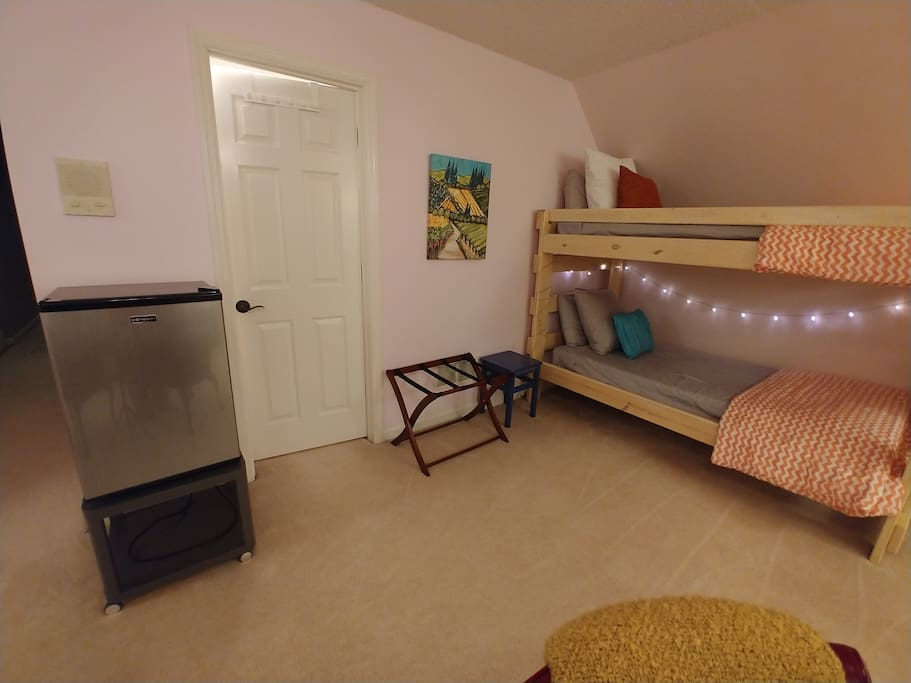 Room has fun bunk beds and a mini fridge