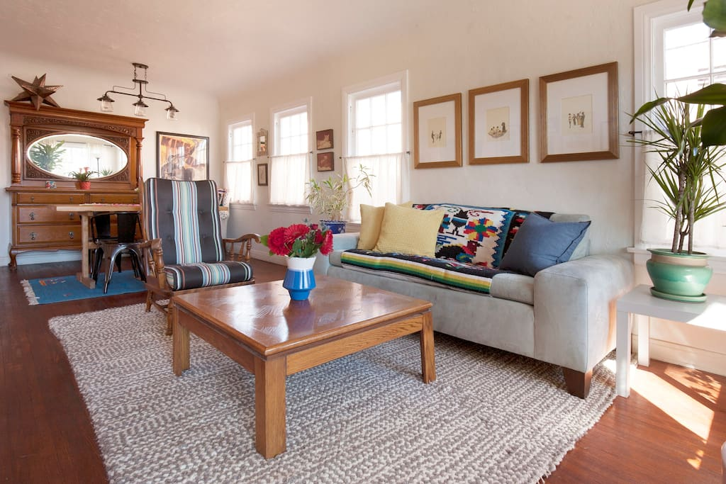 The light-filled living and dining spaces, spacious yet cozy.