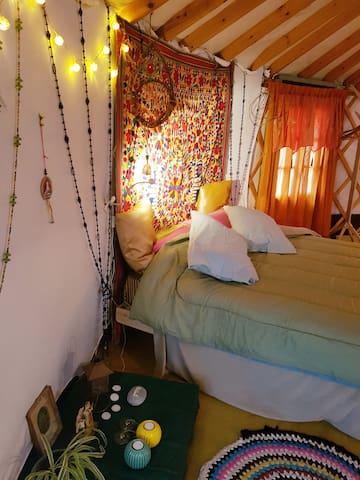 Cozy sleeping bed in yurt...