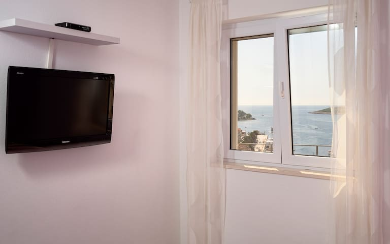 The second bedroom with a magnificent view of the Hvar port.