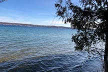 The beautiful waters of Torch Lake await you. To swim or launch a kayak or canoe, one of the lake's few public access ways is a peaceful 25 min walk/2 min drive from the apartment.