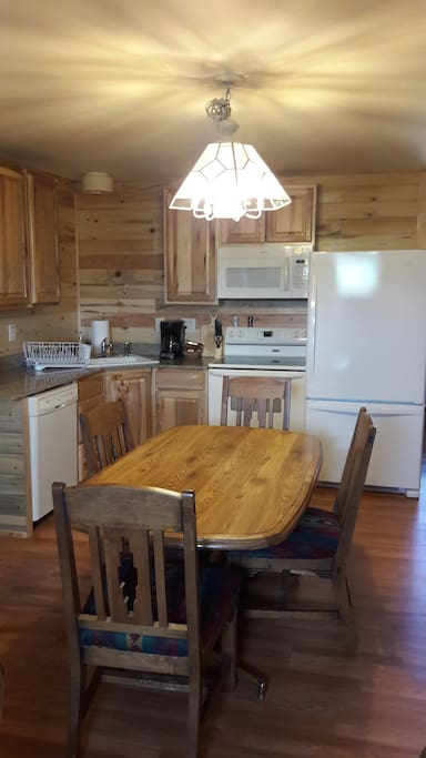 Full Kitchen with seating for up to 6. Fully stocked with all dishes, glassware, flatware, pots/pans etc.