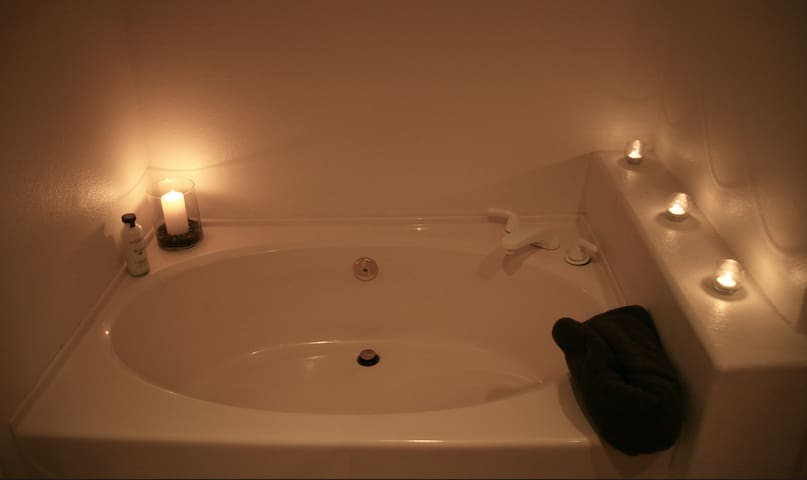 Large soaking tub for two.