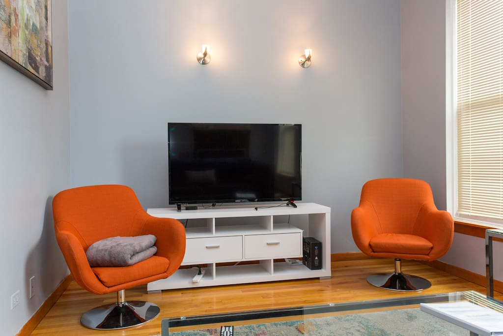 Top floor's 400 sq ft living room with couch, chairs, TV with Netflix and Cable.