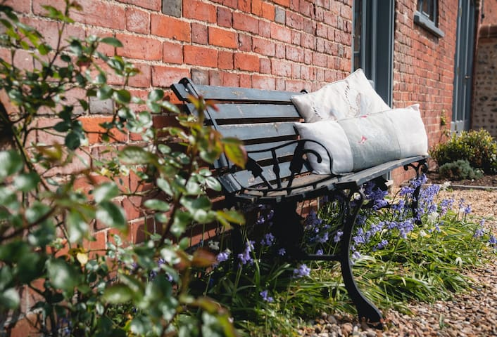 Cozy little bench outside your front door
