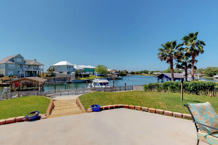Bring your boat to this waterfront home in Perdido Key w/ a dock & large patio!