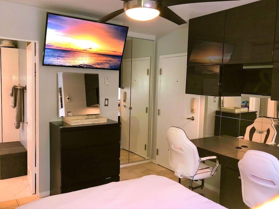 Studio with large TV, custom closet, bathroom