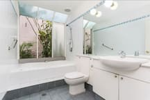 Large bathroom with green outlook downstairs