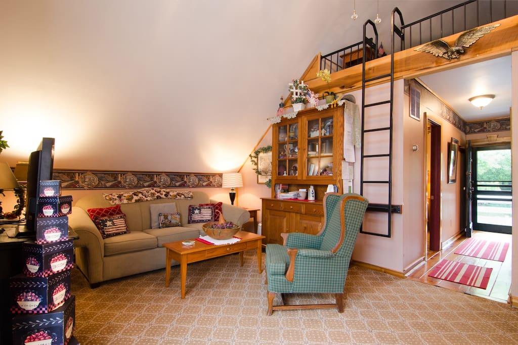 Living Room Area, and Sleeper Loft Ladder