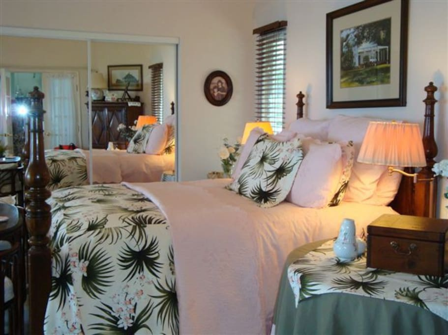 Spacious master suite with California queen bed, sitting area and flat screen TV.