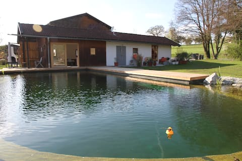 Modern guesthouse directly on the bathing pond