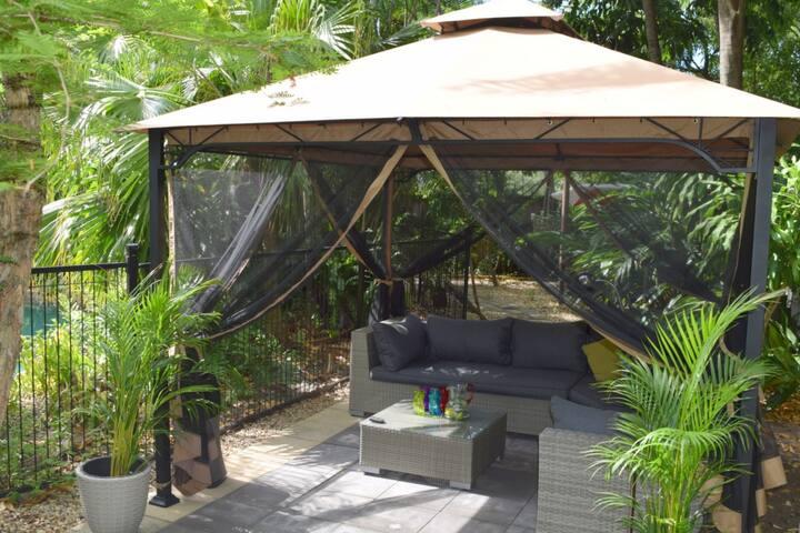 Gazebo with comfy lounge  setting