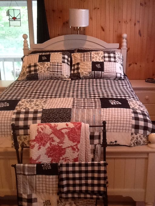 Queen bed with two night tables, with two drawers each and two drawers on either side of the bed. Giving you eight drawers of storage space.