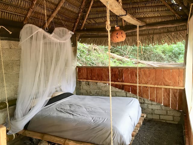 Wake up to Jungle views from your Queen sized hanging bamboo bed