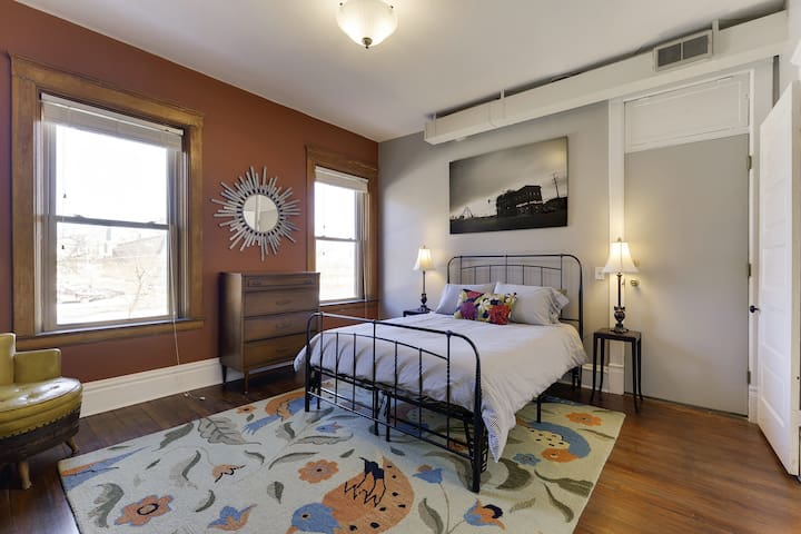 Large master bedroom features a queen-sized bed (memory foam), dresser and closet area to hang clothes, a cozy wool rug, and a skyline view of Downtown Minneapolis.  Down below you'll find a vibrant part of the city with theaters, restaurants, bars, cafes, etc.