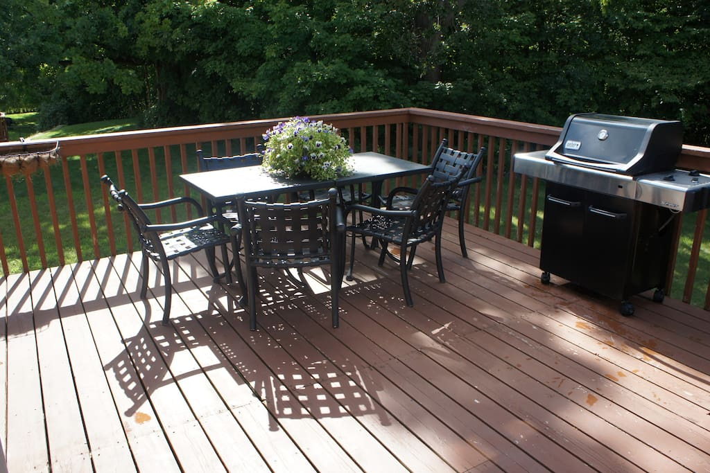 The deck area is huge and overlooks the wooded back yard. There is seating for 6 on the deck and additional seating for children (if needed) with a children's picnic table (not pictured).