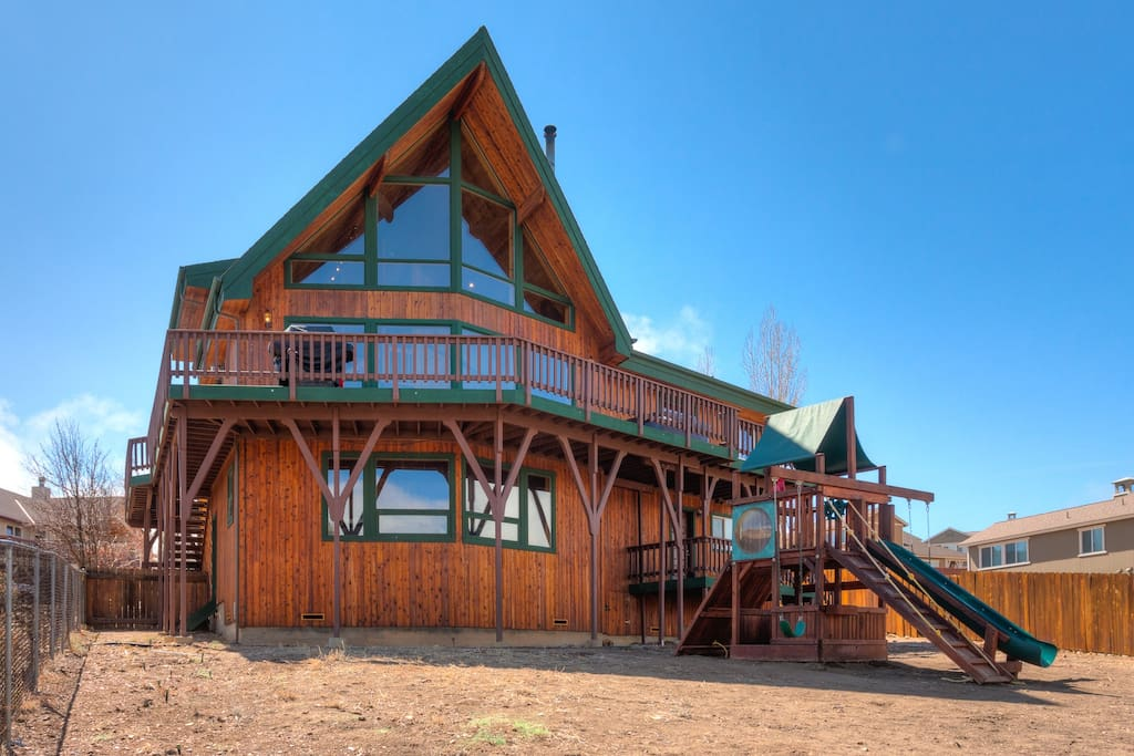 View of House and Play Structure from Large Back Yard