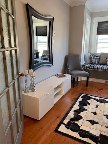 Large bedroom has a comfy reading nook/twin bed