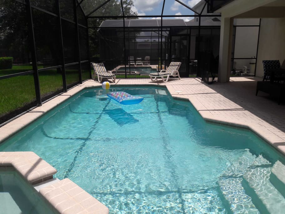 Private pool with spillover spa in screened-in lanai