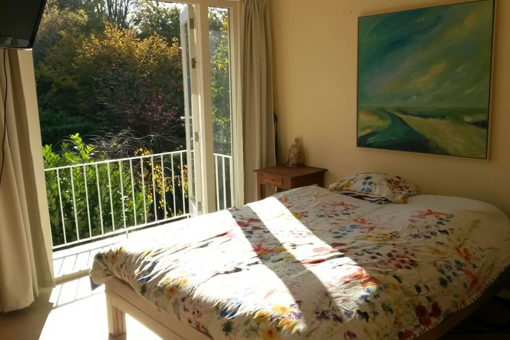 large sleepingroom with balcony at the sunny side first floor