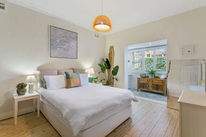 Master bedroom with queen bed and built in wardrobes