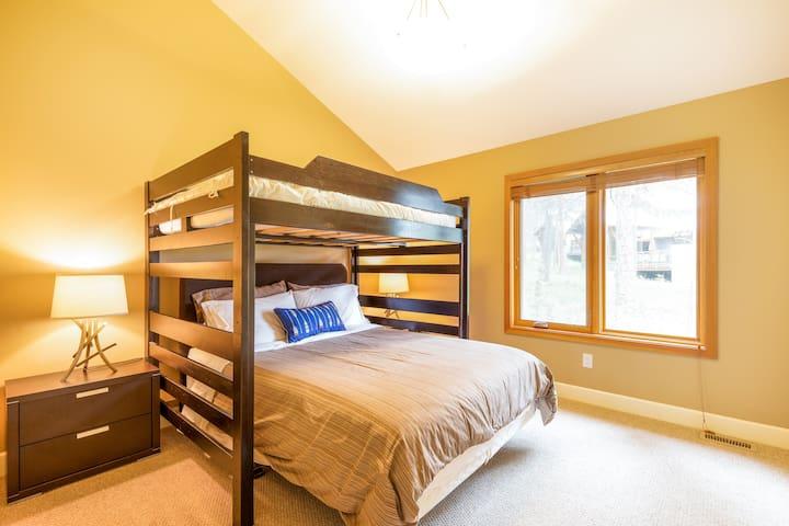 Main floor bedroom with queen bed and double loft bed