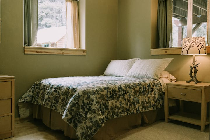 Sage bedroom with full-sized bed