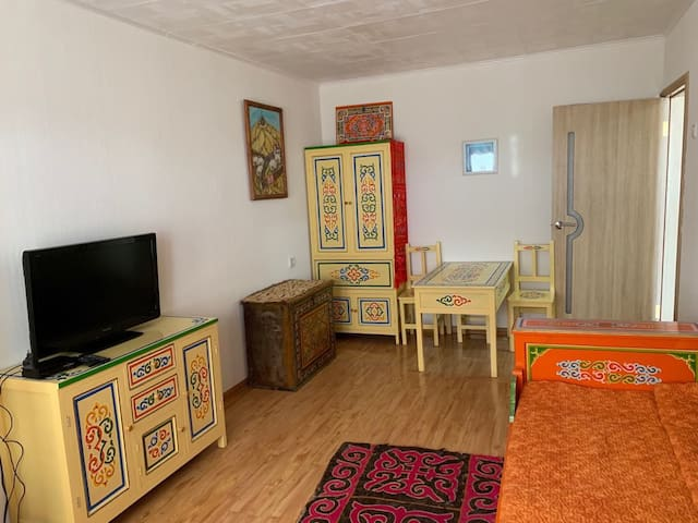 Sun filled apartment with traditional furnishing.