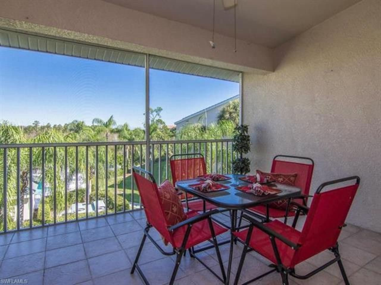 Penthouse view of pool and gardens from the spacious lanai. Enjoy alfresco dining.