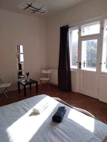Room with balcony near city center