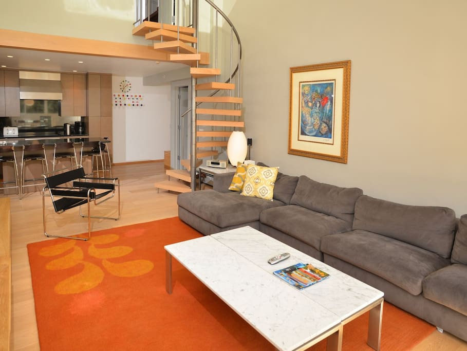 Open living area for mountain viewing, enjoying television and relaxing.