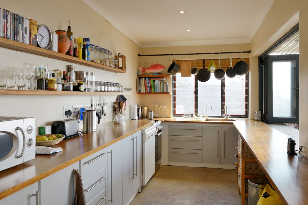Wooden surfaces, dishwasher, cook with a view - counter is inside/ outside. Gas hob electric over.