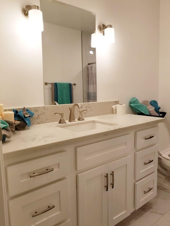 Marble countertop bathroom sink.