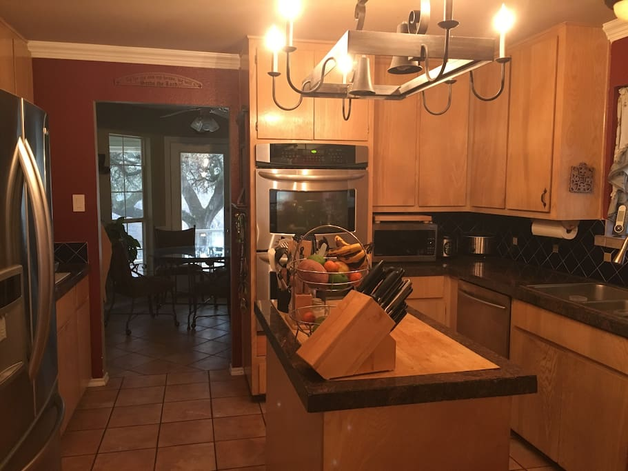 Kitchen with double oven, stove, fridge, ice maker, dishwasher, microwave, coffee maker, etc.