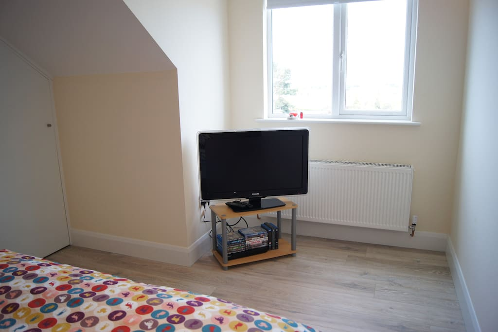 En-suite bedroom with TV and some DVD's