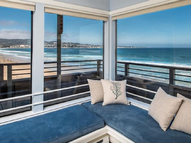 Watch the dolphins and whales from this beautiful beachfront condo