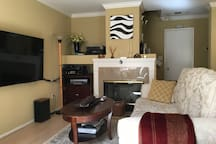 Living/family room with big screen HDTV/Apple TV/Netflix/Cable TV/HBO movie channels.