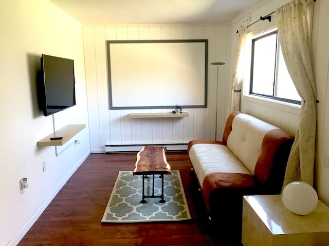 Lower level living room, includes 6 foot whiteboard.