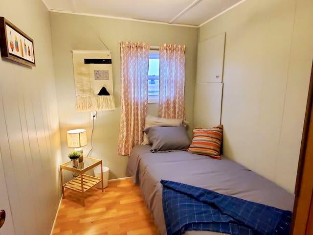 2nd bedroom -  comfortable new single bed, nightstand, closet.